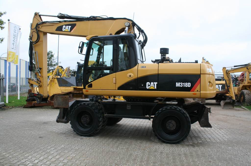 Caterpillar M 318 D TOP CONDITION