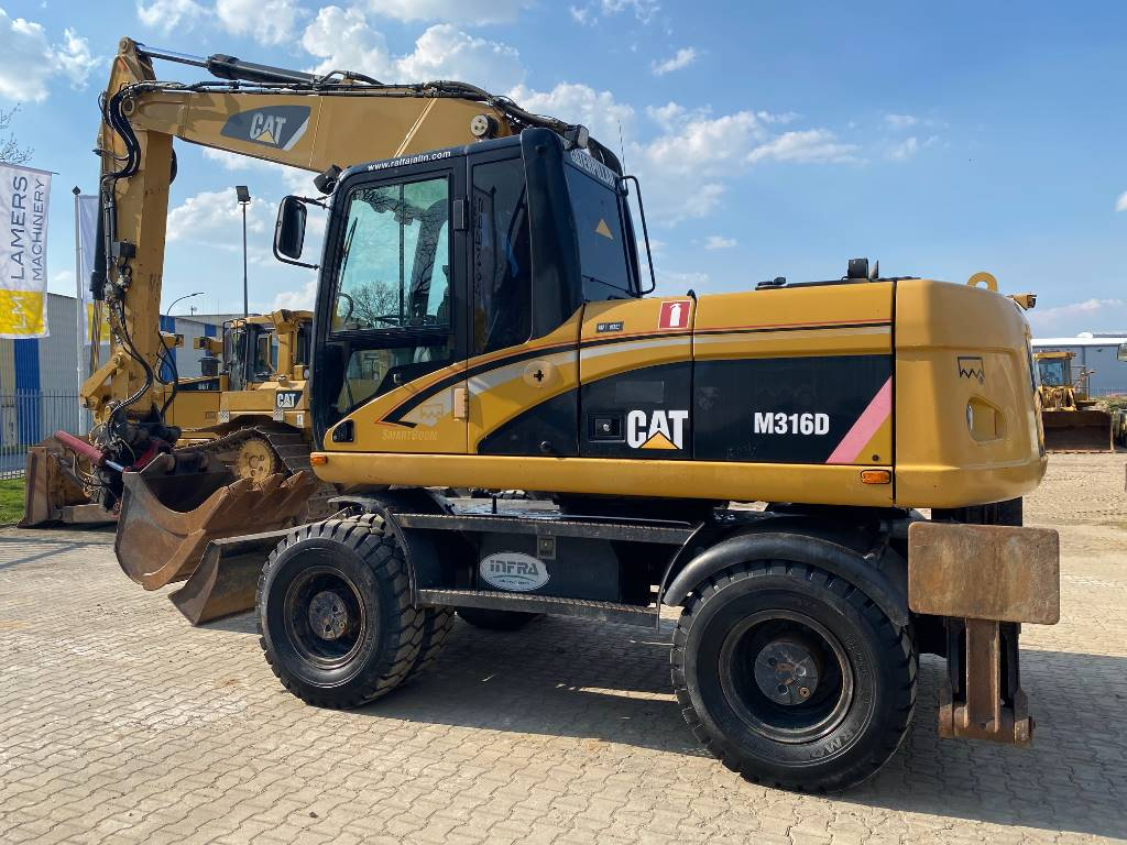 Caterpillar M 316 D + registration papers